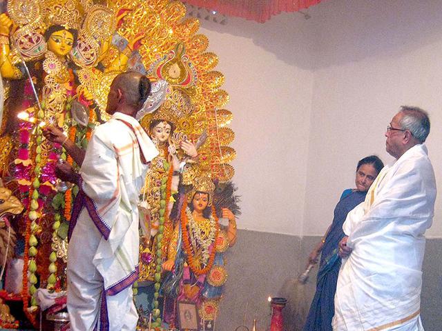 President Pranab Mukherjee during Durga Puja at his ancestral home in Bolpur, West Bengal. (HT Photo)