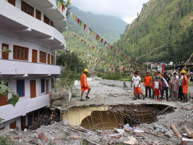 A damaged portion of a building near the Manikaran Sahib gurudwara in Kullu district. (Aqil Khan/HT)