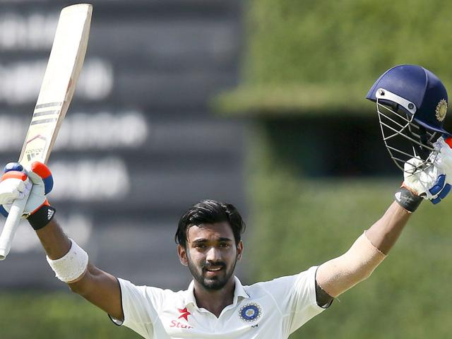 Rahul raises his bat in celebration after scoring his century. (Reuters Photo)