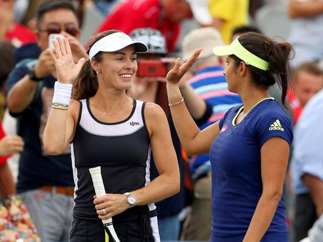Martina Hingis of Switzerland and Sania Mirza of India during the Rogers Cup in Toronto, on August 14, 2015. Mirza and Hingis advanced to the quarter-finals of the Cincinnati Open with a win over the unseeded German-Polish pair of Julia Goerges and Klaudia Jans-Ignacik, on August 19, 2015. (AFP Photo)