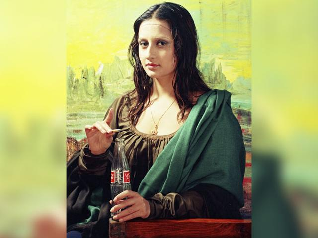 A Pakistani artist posing as Mona Lisa, with a lit cigarette and a Coca-Cola bottle in her hand, is among 70 photographs on display at Max Mueller Bhavan, seeking to present the troubled nation in a new light.