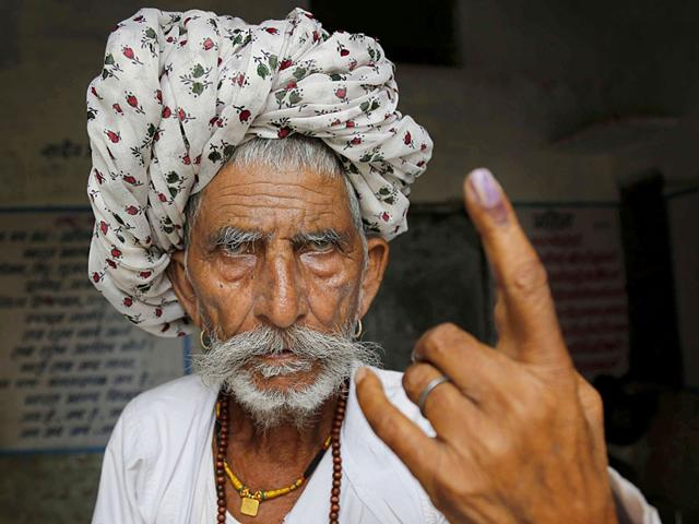 An old citizen shows his inked finger after casting vote during Municipal Corporation polls at a polling booth in Ajmer, Rajasthan, India on Monday, August 17, 2015 (Deepak Sharma/HT Photo)