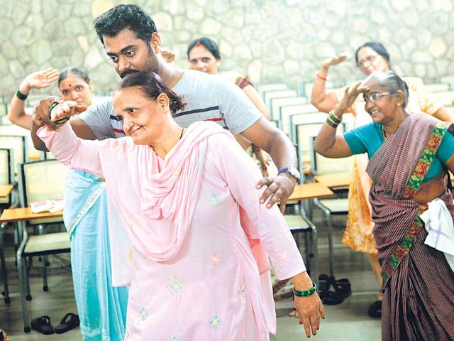 Senior citizens practise their dance steps at the geriatric centre at Tata Institute of Social Sciences. (Arijit Sen/HT photo)