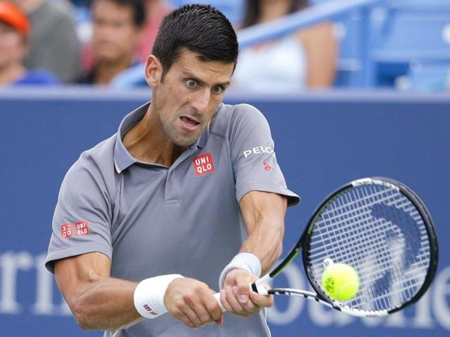 Serbia's Novak Djokovic returns a shot against Benoit Paire of France during their match at the Western and Southern Open in Mason, Ohio, on August 19, 2015. (AP Photo)
