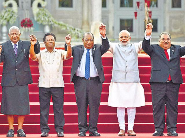 PM Modi joins hands with heads of governments at the second summit of Forum for India-Pacific Island Countries in Jaipur on Friday. (PTI Photo)