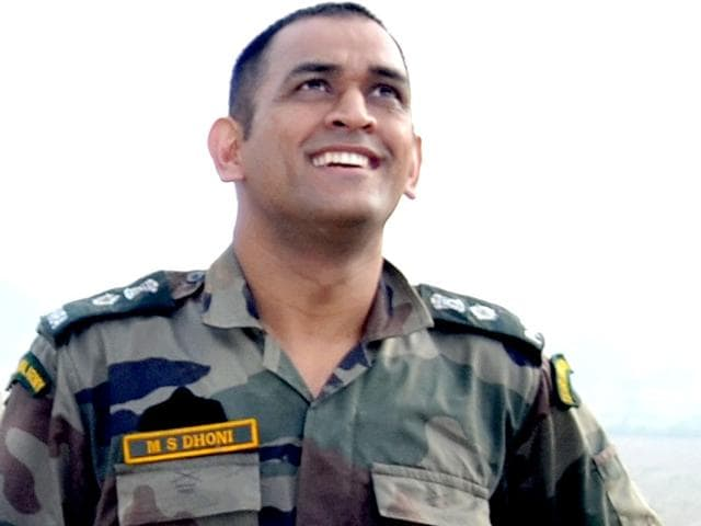 Lieutenant Colonel Mahendra Singh Dhoni after his successful fourth jump. (HT Photo)