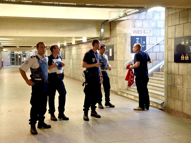 French police stand inside the main train station in Arras, northern France. (AFP Photo)