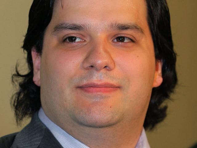 This file picture taken on February 28, 2014 shows Mark Karpeles, president of troubled MtGox Bitcoin changer, at a press conference in Tokyo. The former head of MtGox faced fresh criminal charges on August 21, 2015 over allegations he stole 2.6 million USD from clients, as police questioned him about hundreds of millions of dollars worth of missing Bitcoins (AFP Photo)