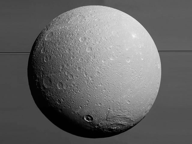 This view from Nasa's Cassini spacecraft looks towards Saturn's icy moon Dione, with the giant planet and its rings in the background. (Picture credit: Nasa official website)
