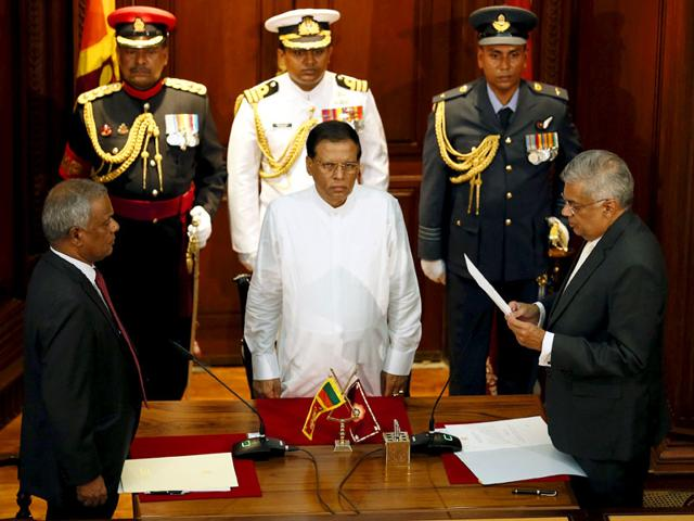 Ranil Wickremesinghe (R), leader of the United National Party, reads his oath of office next to Sri Lanka's President Maithripala Sirisena as he is sworn in as country's new Prime Minister in Colombo. (Reuters)