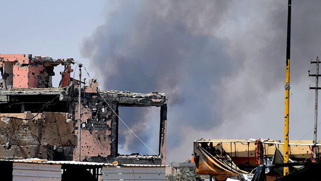 Smoke rises above a damaged building following a US-led coalition airstrike against Islamic State positions during a military operation to regain control of the eastern suburbs of Ramadi, in Anbar province.