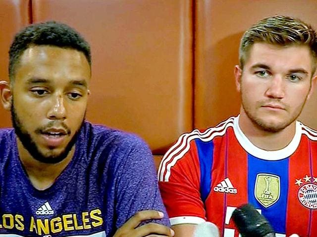 Anthony Sadler, a senior at Sacramento State University (left) sits with Alek Skarlatos, US national guardsman from Roseburg, Oregon. They are amongst the three Americans who helped overpower the France train gunman. (AP Photo /APTN)