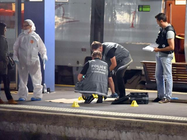 Police work on a platform next to a Thalys train of French national railway operator SNCF at the main train station in Arras, northern France. (AFP Photo)