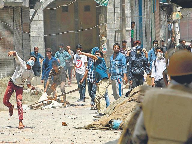Kashmiris throw stones during a protest in Srinagar in May 2015. (Javed Dar/Xinhua Press)