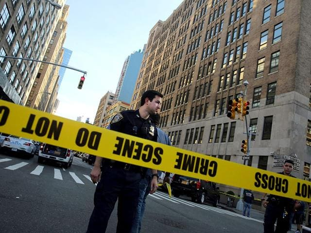 Police cordon off the scene in lower Manhattan where two people were shot at the Federal Immigration Court in New York City. (AFP Photo)