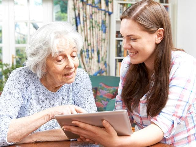 Teach technology to your parents with patience and discover true joy. (Shutterstock Photo)
