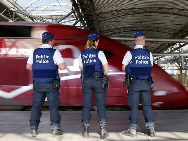 Belgian police officers stand guard on a platform at the Thalys high-speed train terminal at Brussels Midi/Zuid railway station. A machine gun-toting attacker wounded three people on the train on Friday before being overpowered by passengers who included an American soldier. (Reuters Photo)