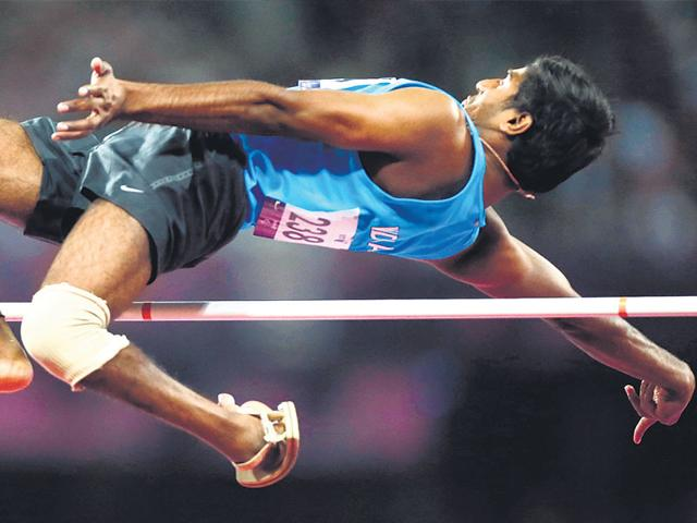 Athlete Girisha HN, who has a club foot, won a silver medal in high jump at the London Paralympics in 2012. Three years before this win, lack of resources had led him to quit sport to focus on supporting his family. (Matt Dunham/AP)