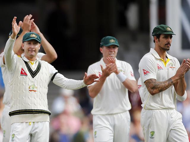 Australian captain Michael Clarke, left, waves goodbye at the end of the fifth and final Ashes Test, his last international match, with Mitchell Johnson, right, and teammates at The Oval, on August 23, 2015. (Reuters Photo)