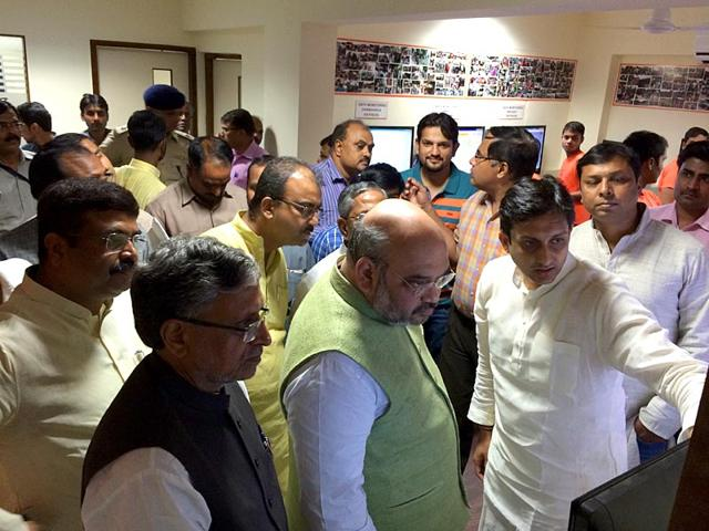 Bharatiya Janata Party national president Amit Shah is micromanaging the Bihar campaign at the grassroots level through three key men - union minister Dharmendra Pradhan, party state in-charge Bhupender Yadav and business professional Rituraj Sinha. (HT Photo)