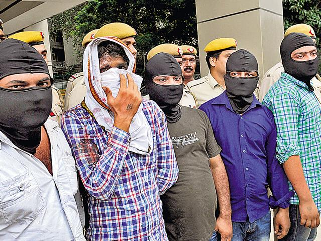 The five men arrested after the revenge killing of an alleged gangster early on Sunday. This was the second time in five months that a gang war bloodied south Delhi's streets. (Sushil Kumar/HT Photo)