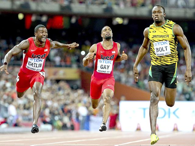 Justin Gatlin, left, and Tyson Gay, centre, of the United States and Usain Bolt of Jamaica at the finish line of the men's 100m final during the 15th IAAF World Championships at the National Stadium in Beijing, on August 23, 2015. Bolt won in 9.79 seconds. (Reuters Photo)