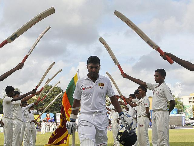 Sangakkara leaves the field after being dismissed for 18 in his final Test innings. (AP Photo)