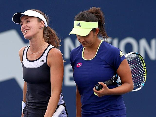 Sania Mirza, right, and Martina Hingis after beating Hao-Ching Chan and Yung-Jan Chan of Chinese Taipei at the Rogers Cup in Toronto, on August 14, 2015. Mirza-Hingis lost to the Chans in the semi-finals of the Cincinnati Masters, on August 22, 2015. (AFP Photo)