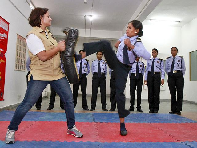 A trainee women security guard kicking a punching bag at 24 Secure Training Academy in Gurgaon. (HT Photo/Sanjeev Verma)