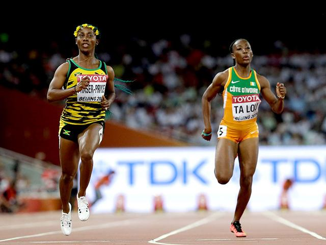 Jamaica's Shelly-Ann Fraser-Pryce, left, and Ivory Coast's Marie-Josee Ta Lou run in the women's 100m semi-final at the World Athletics Championships at the Bird's Nest stadium, Beijing, on August 24, 2015. (AP Photo)