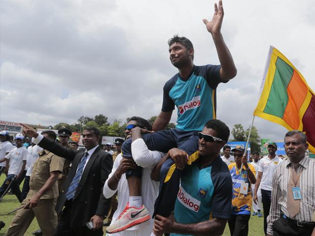 Sri Lankan players carry Kumar Sangakkara on their shoulders and give him the round of the ground at the end of the second Test between Sri Lanka and India in Colombo on August 24, 2015. (AP Photo)