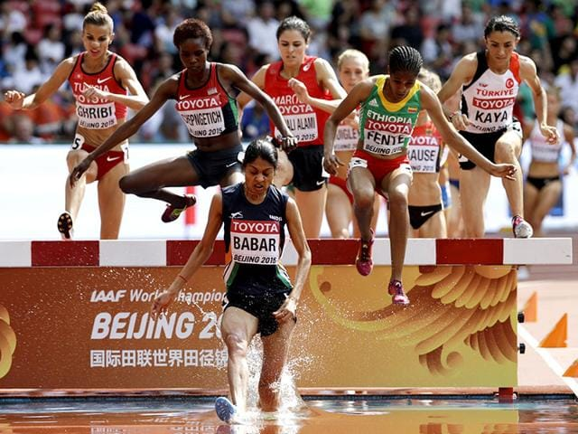 Barbados' Lalita Shivaji Babar leads the filed through the water jump in heat two of the women's 3000m steeplechase at the World Athletics Championships at the Bird's Nest stadium in Beijing. (AP Photo/Kin Cheung)