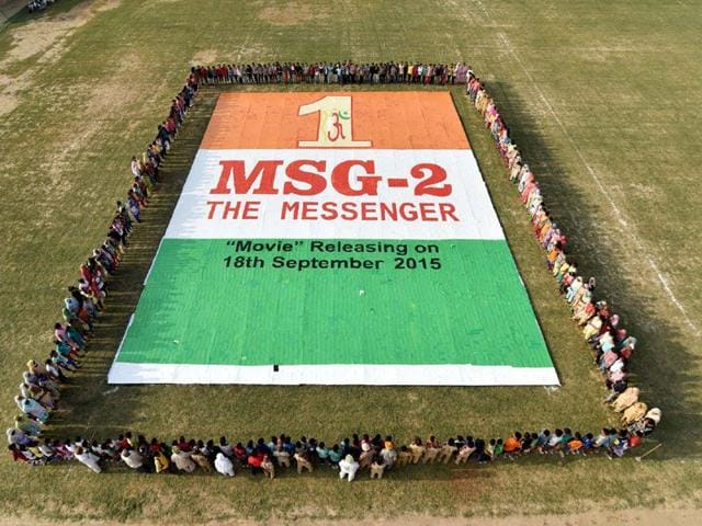 The 2,146.32 sq ft greeting card mosaic in tricolor made by dera followers at Shah Satnam Ji sports complex in Sirsa. (HT Photo)