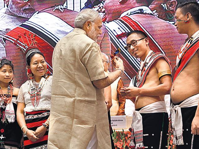 PM Narendra Modi interacts with performers during a function marking the birth centenary of freedom fighter Rani Gaidinliu. (Virendra Singh Gosain/ HT Photo)