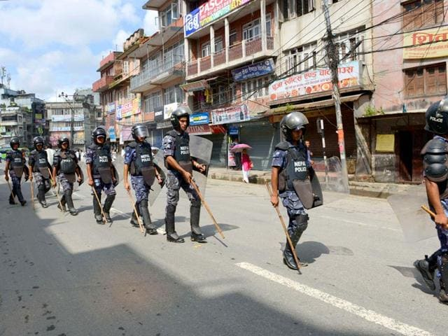Nepalese police personnel detain a protester (C) during a general strike organized by the Nepal Federation of Indigenous Nationalities (NEFIN) demanding autonomous regions based on ethnicity to be drafted into the new constitution in Kathmandu. At least six policemen were killed in protests over the Constitution (REUTERS Photo)