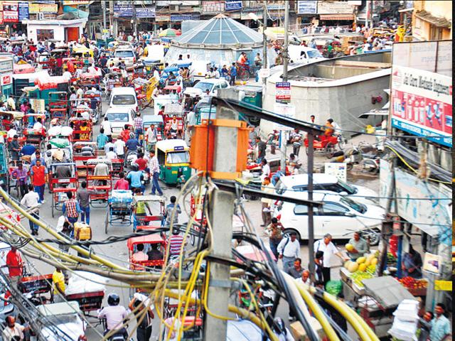 It's a free-for-all in Old Delhi with all kinds of vehicles and pedestrians jostling for space at any time of the day. (Ajay Aggarwal/ HT Photo)