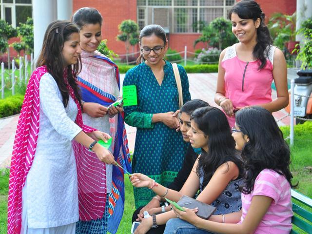 Girls campaigning at a hostel in Panjab University on Sunday. Karun Sharma/ HT