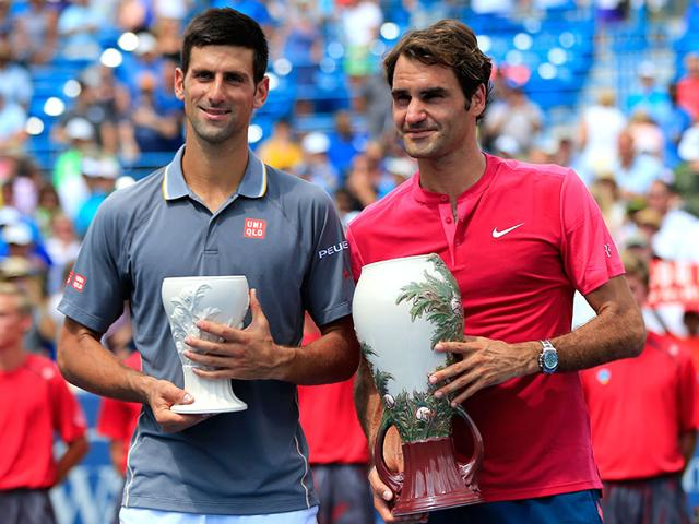 Roger Federer of Switzerland and Novak Djokovic of Serbia pose with the trophies after Federer won in two sets to win the men's singles final at the Western & Southern Open in Cincinnati, Ohio.(Rob Carr/AFP)