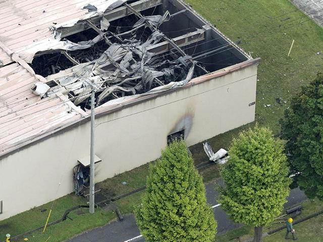 A warehouse which caught fire after an explosion is seen at the US Army Sagami General Depot in Sagamihara, southwest of Tokyo in Japan, in this aerial photo taken by Kyodo on August 24, 2015. Firefighters are still battling a fire triggered by an explosion at a US Army base in Sagamihara, Japan, but there are no reports of injuries, a Pentagon spokesman said Sunday. (Reuters/Kyodo)