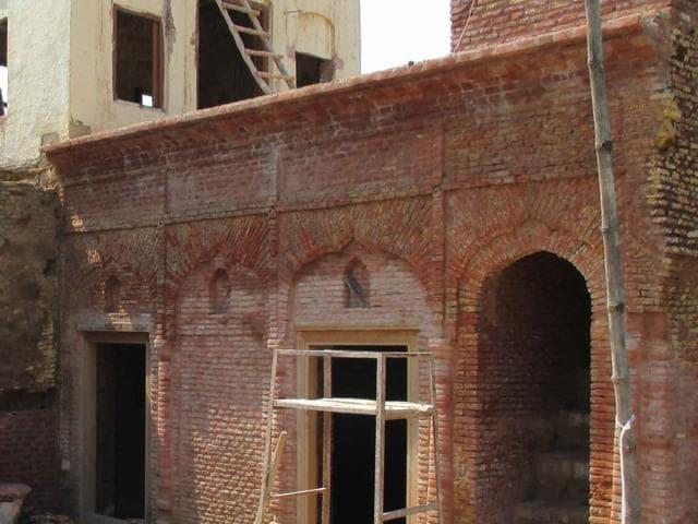 Renovation work of martyr Bhagat Singh's ancestral home under progress at Khatkarh Kalan village in Nawanshahr. (HT Photo)