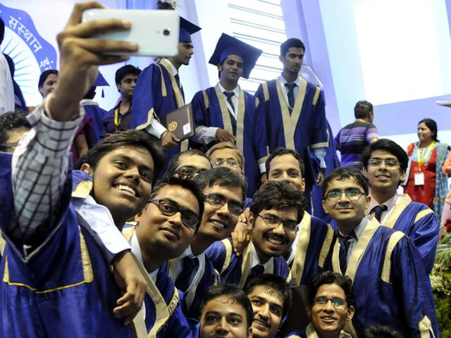 IIT-Indore students take selfies after they are conferred degrees at the 3rd convocation of the institute at their Simrol campus, on Monday. (Arun Mondhe/HT)