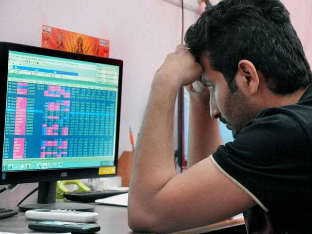 A broker reacts to the Monday bloodbath at the BSE Sensex. (PTI photo)