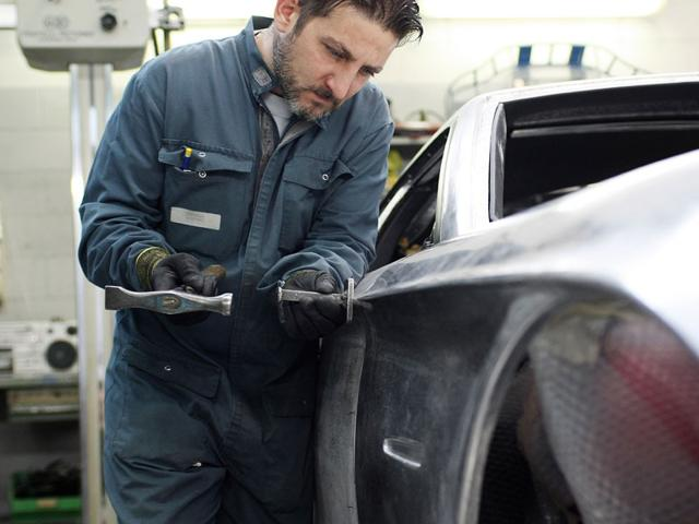 Panel Assembly : Although the body is formed by hand-form aluminum panels, the company also uses cutting-edge computer modeling to ensure that panels will fit exactly, that there is no vibration, and to ensure that the car will maintain or improve on its existing performance levels. Photo:AFP