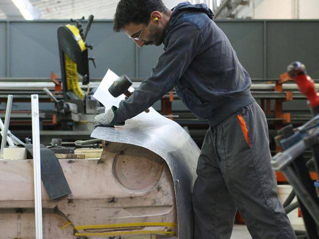 Panel forming and beating : Each panel is shaped over an exact 1:1 scale epoxy buck by craftsmen. 'The elegance and purity of the car lines could only be achieved through the manual beating of aluminium panels,' says Mancardi. Photo:AFP