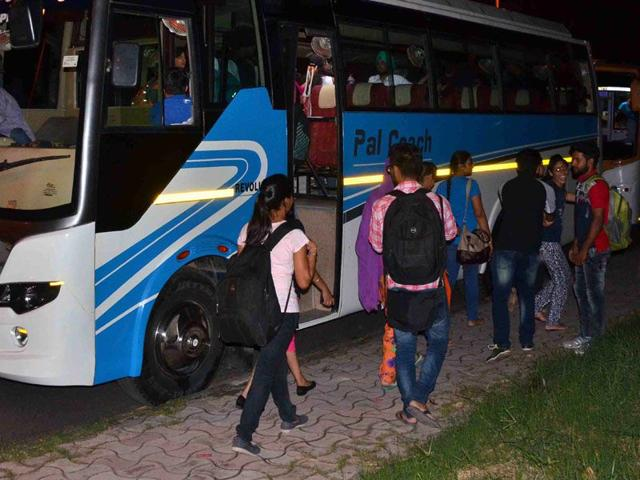 Students being taken on a trip on buses parked near Gate No. 3 at Panjab University on Monday night. (Karun Sharma/HT)