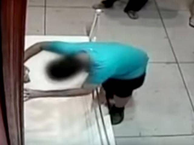 A screengrab of a 12-year-old Taiwanese boy tripping and accidentally smashing a hole in a Pablo Porpora painting.