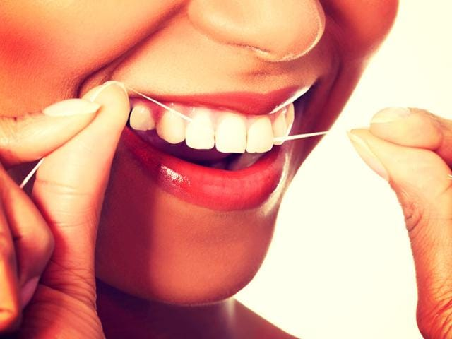 The woman mentioned to her doctors that she had voluntarily started a vigorous dental flossing regimen. (Photo: Shutterstock)