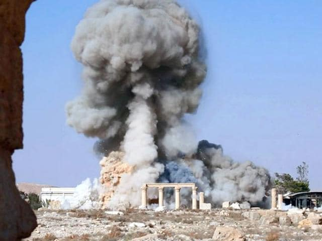 This undated photo released on August 25 shows smoke from the detonation of the 2,000-year-old temple of Baalshamin in Syria's ancient caravan city of Palmyra. (Islamic State social media account via AP)