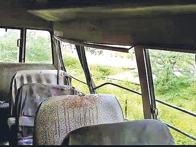Blood-stained interior of the Indo American School bus that rammed into a parked truck in Udaipur on Monday.(HT Photo)