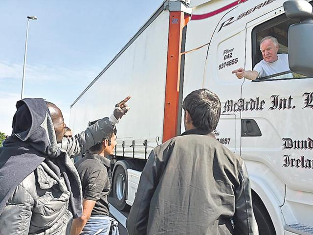 Migrants try to board lorries bound for the United Kingdom from Calais, France in July this year. (Getty images)